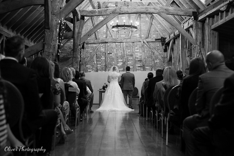 Marriage ceremony at Bassmead Manor Barns