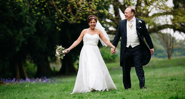 married couple at Orton hall wedding photography by Peter Oliver