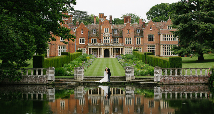 Married couple in front of Longstowe Hall