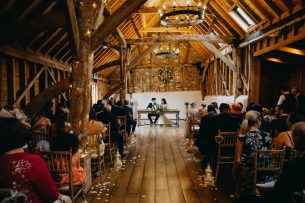married couple posing in bassmead manor barn