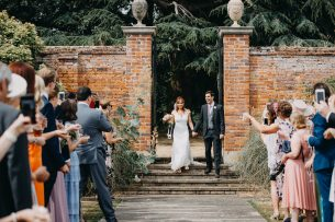 married couple enter the irnham hall