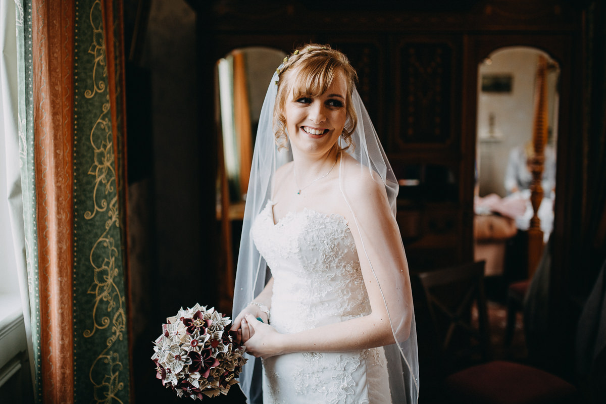 bride getting ready at Wroxall Abbey