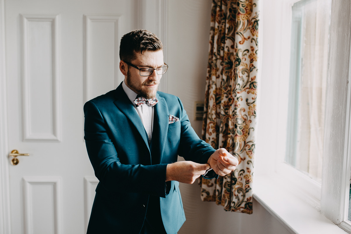 a groom is getting ready
