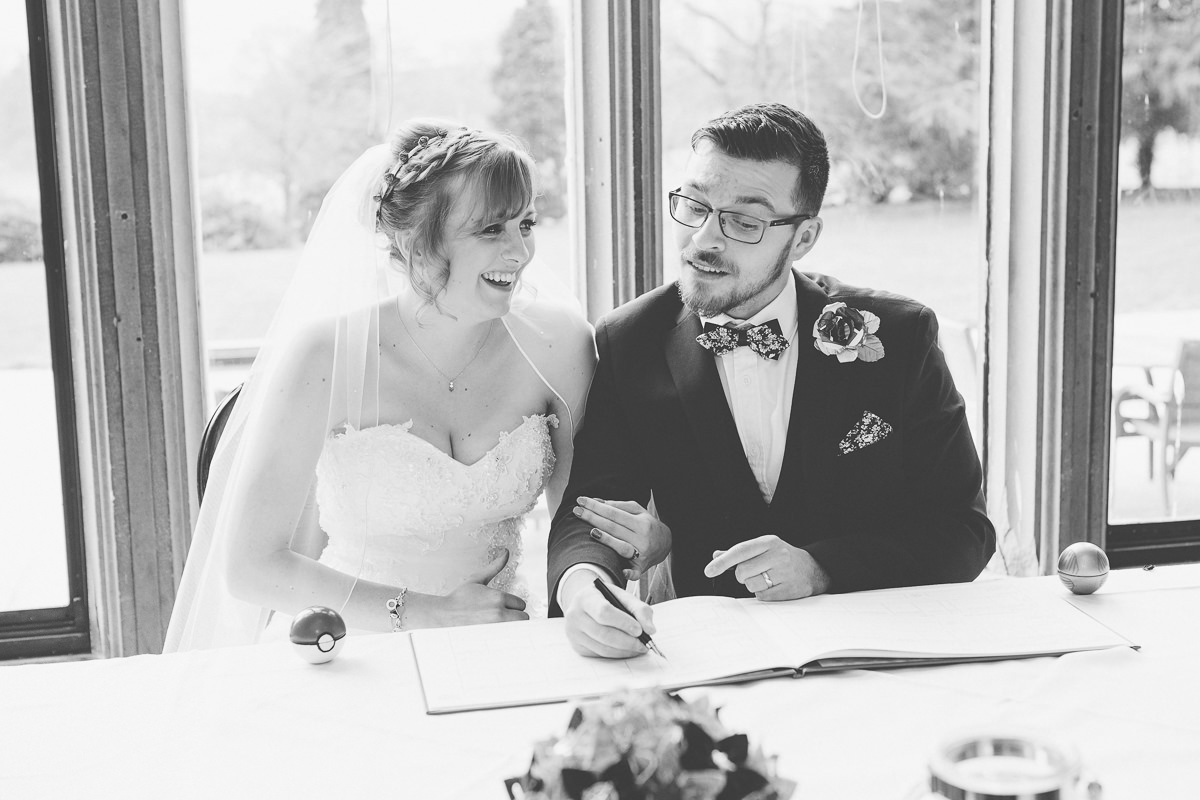 signing register at Wroxall Abbey wedding