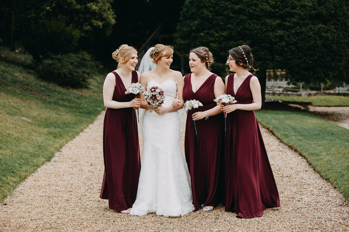 brides outside Wroxall Abbey