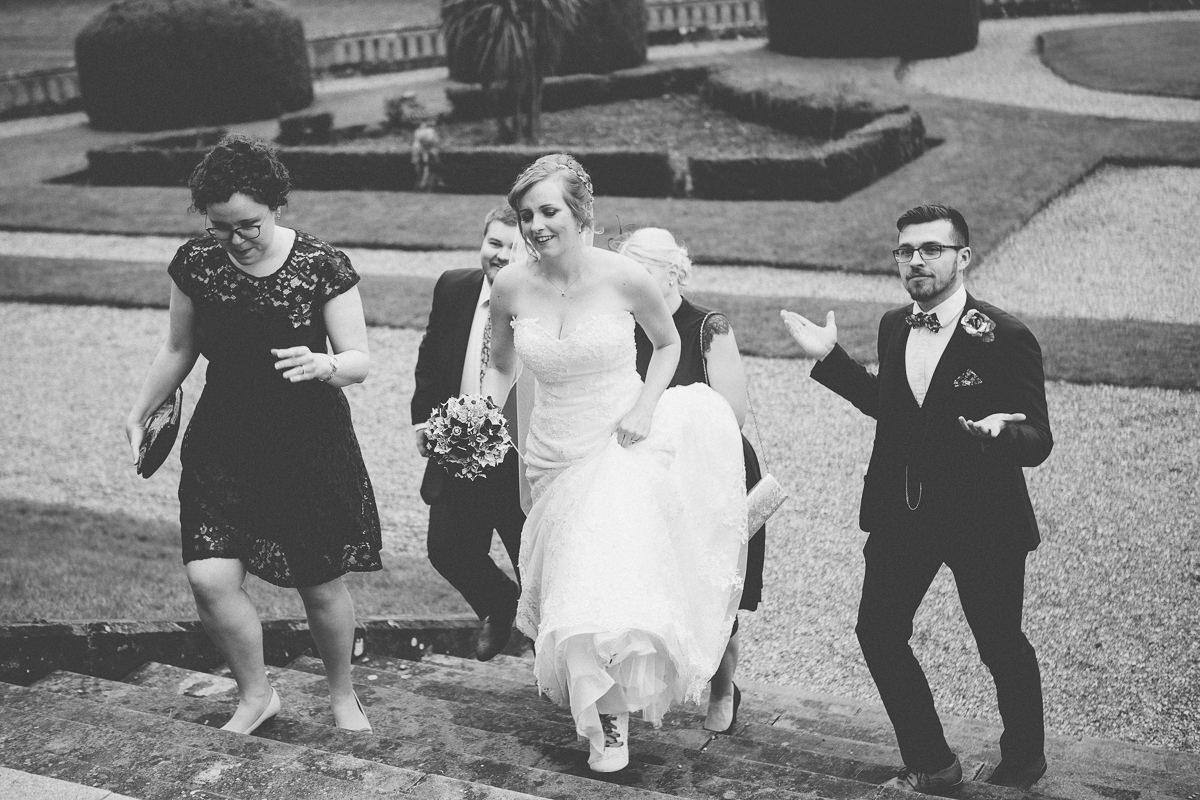 wedding at Wroxall Abbey bride and groom walking inside