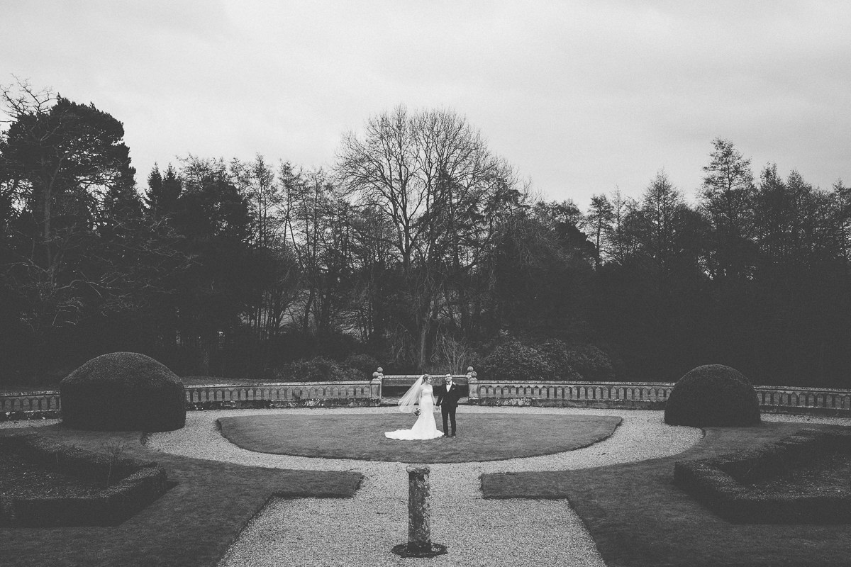 bride and groom in the gardens at Wroxall Abbey
