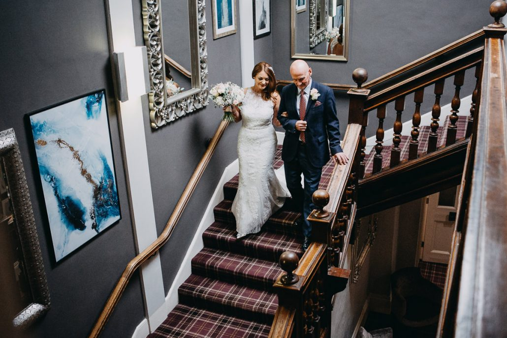 bride & father walking down the staircase in Barton Hall
