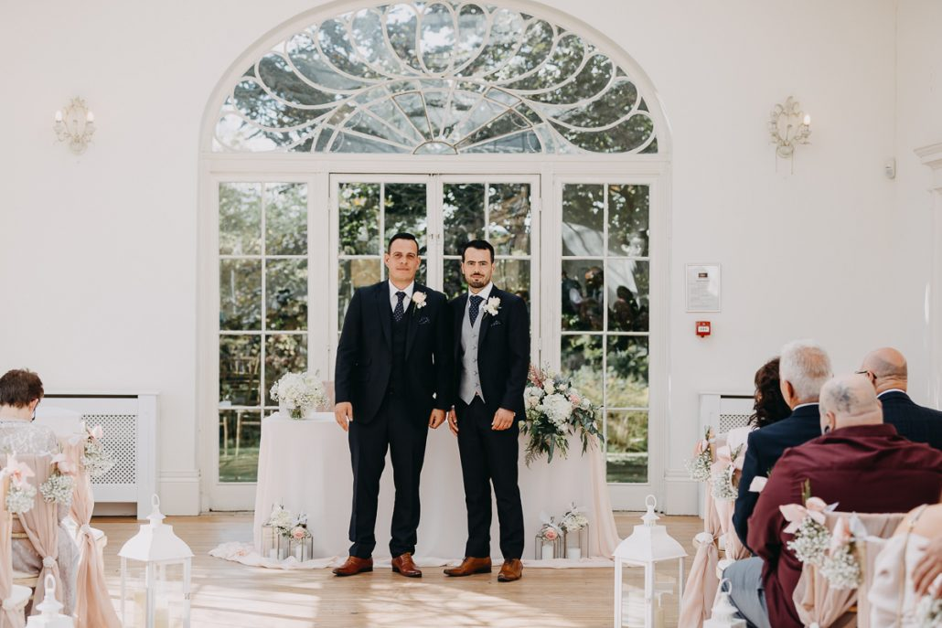 groom and best man waiting in orangery at Barton Hall