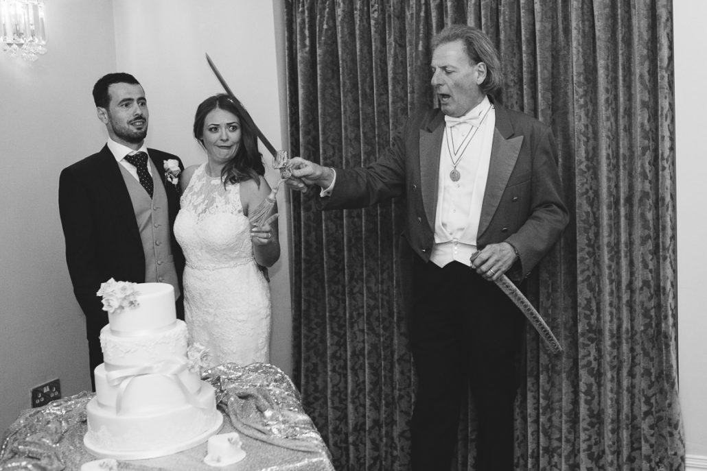 cutting of the cake with a massive sword