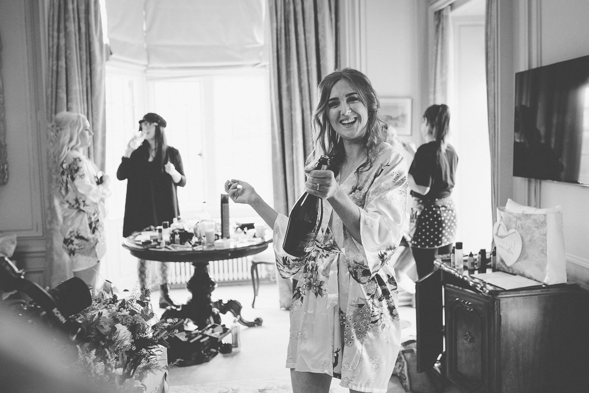 bridesmaid opening Champagne