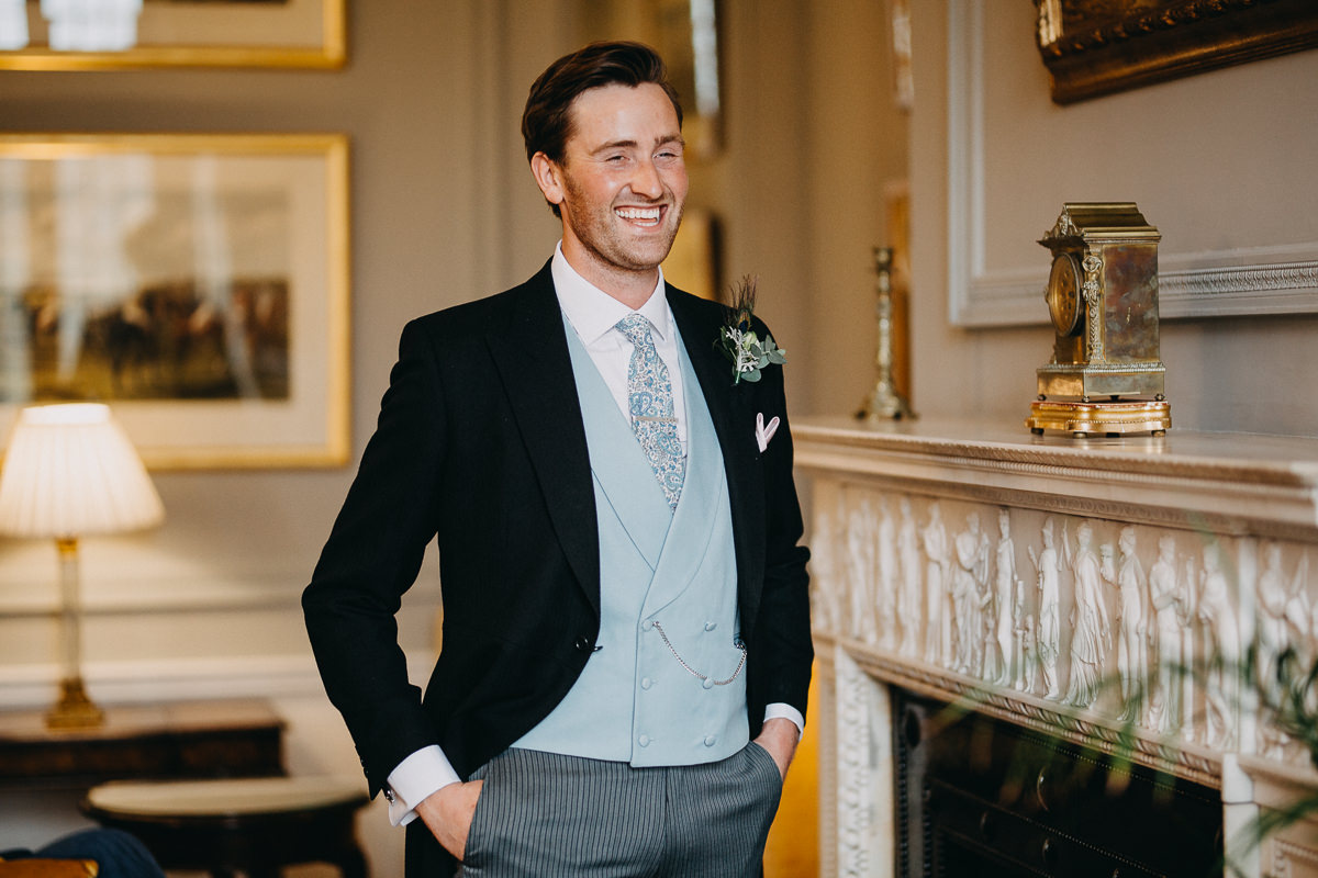 groom in the room of Rushton Hall