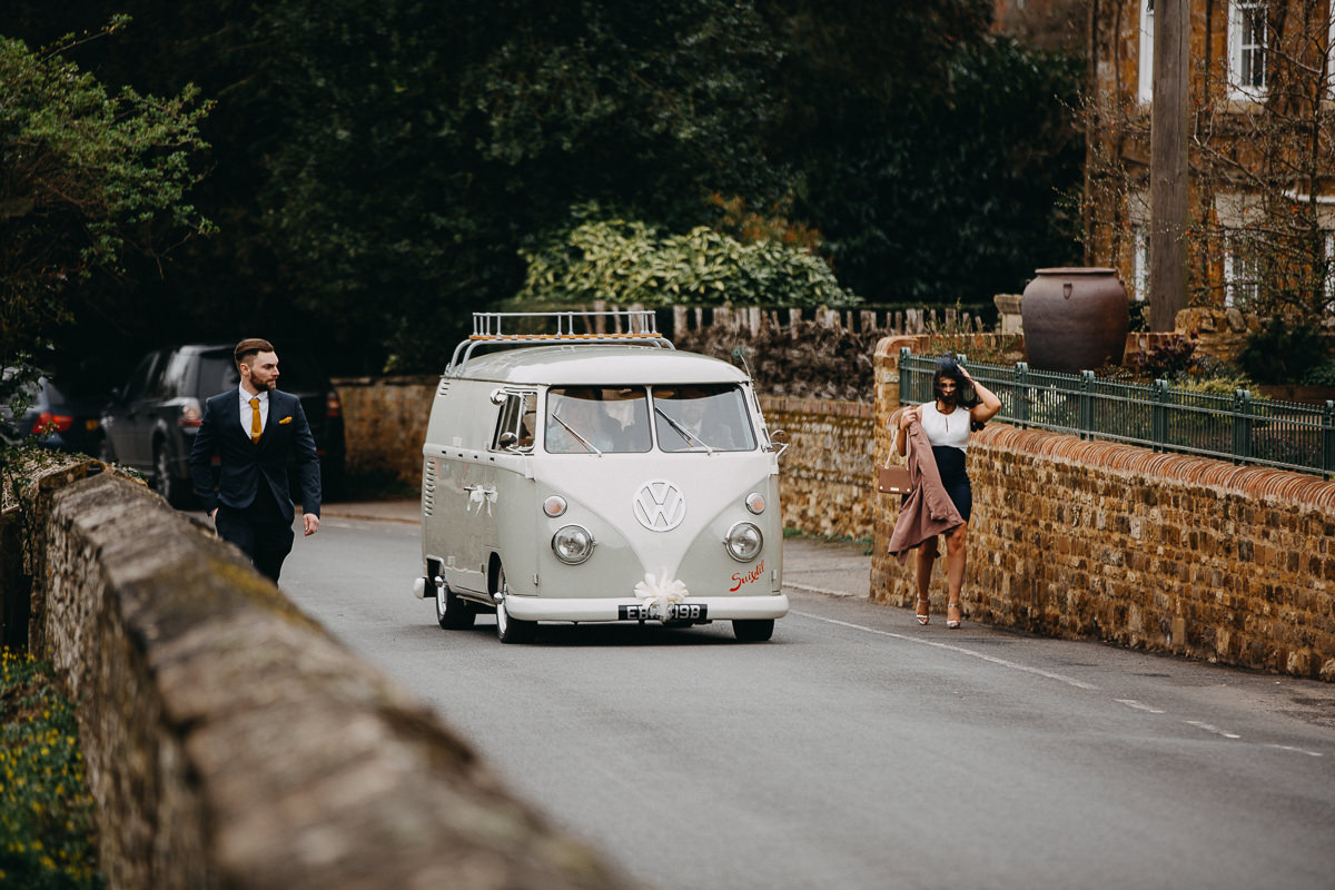 camper van with the bridesmaids arriving at the All Saints church next to Rushton Hall