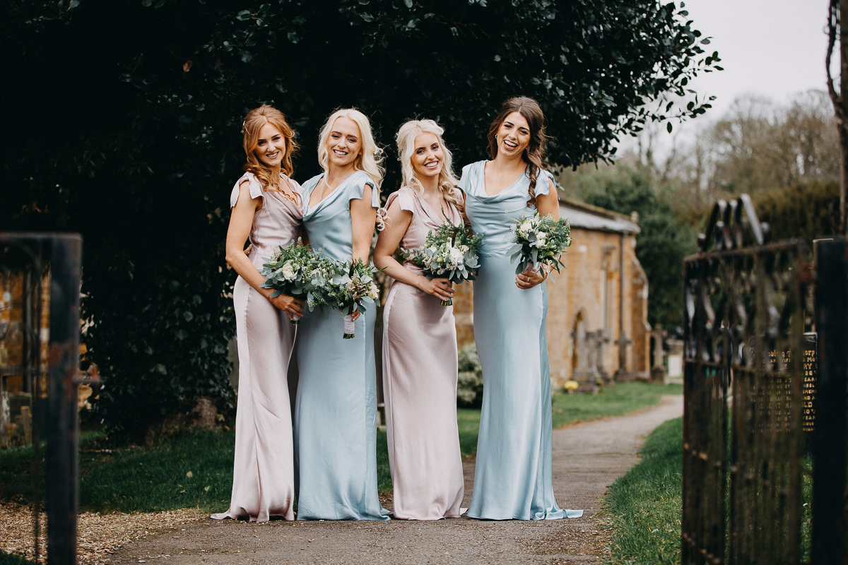 bridesmaids at All Saints church before ceremony Rushton