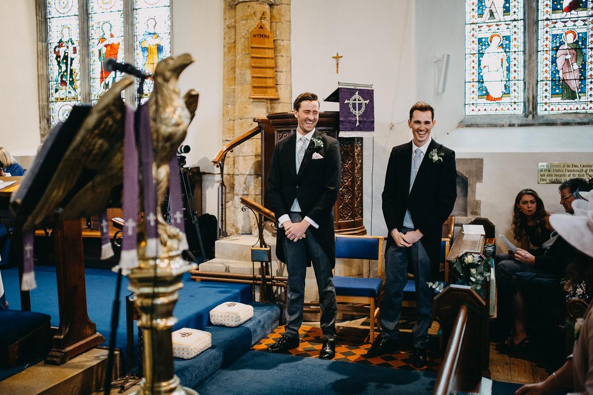 groom inside All Saints Church Rushton