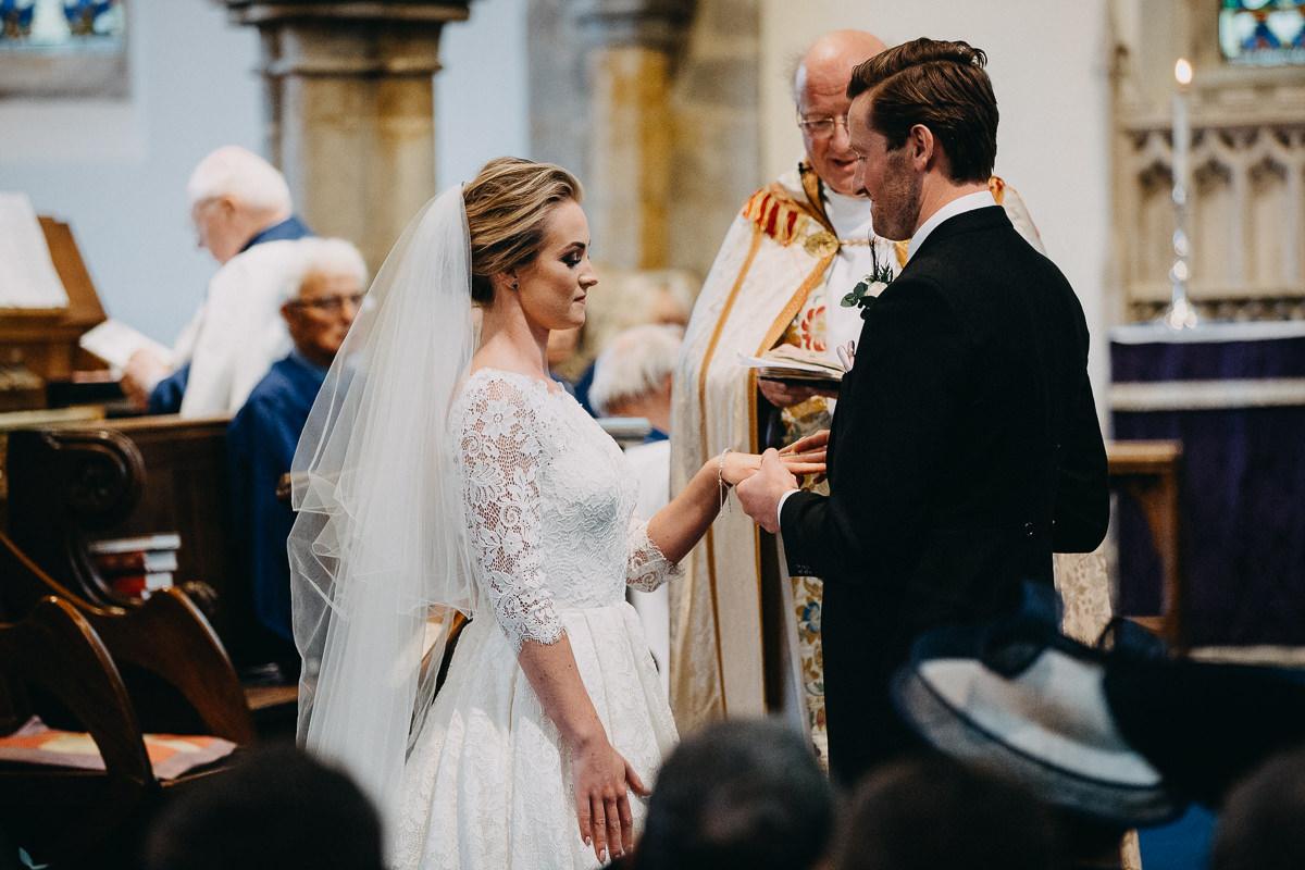 exchanging rings church wedding in Rushton