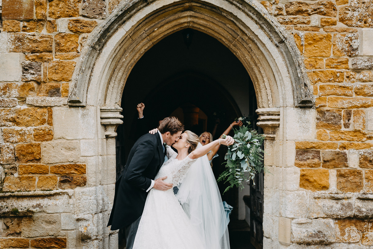 just married outside all saint church Rushton