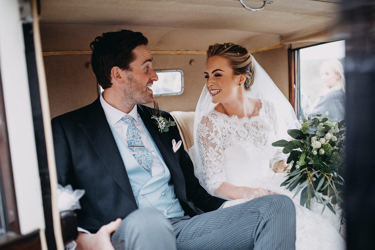 bride and groom in wedding car after ceremony