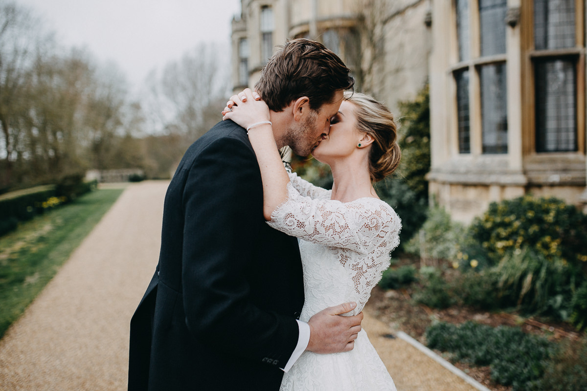 married couple kissing Rushton Hall
