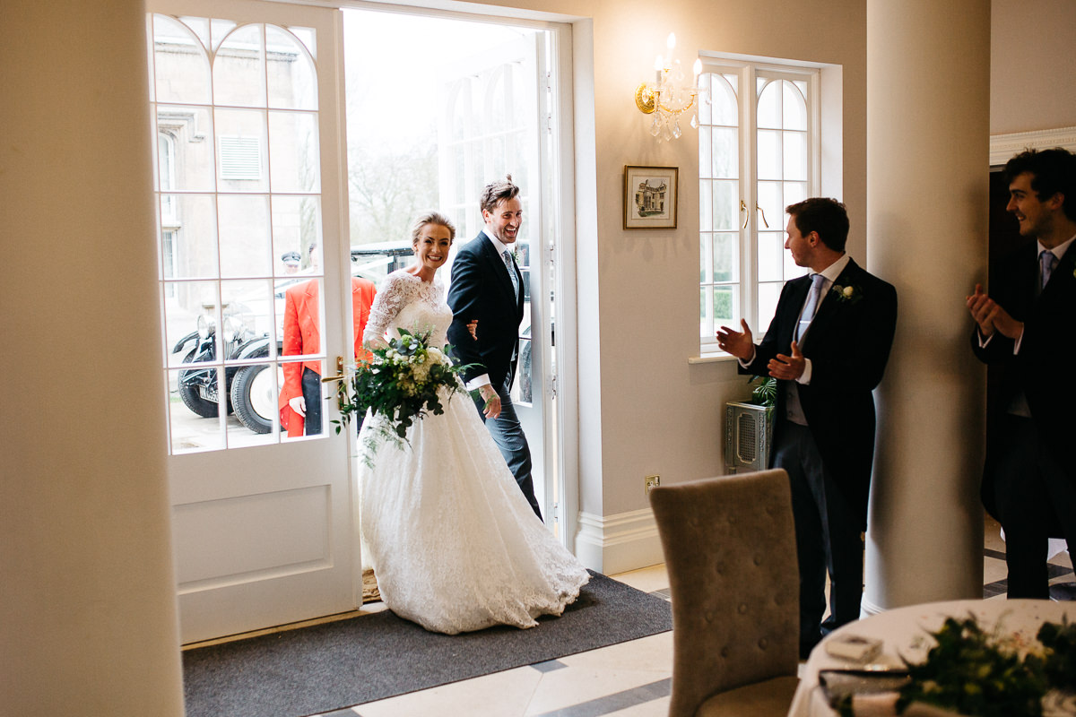 just married enter orangery at Rushton Hall