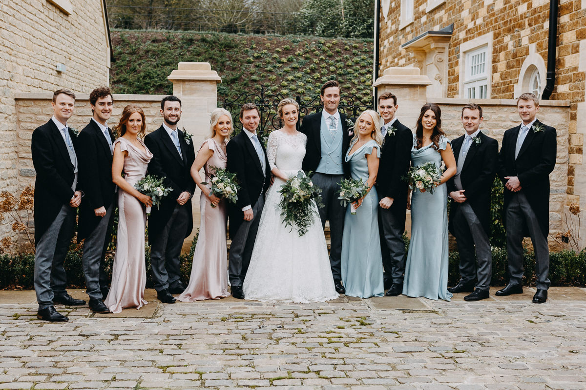 wedding party photo outside Rushton Hall
