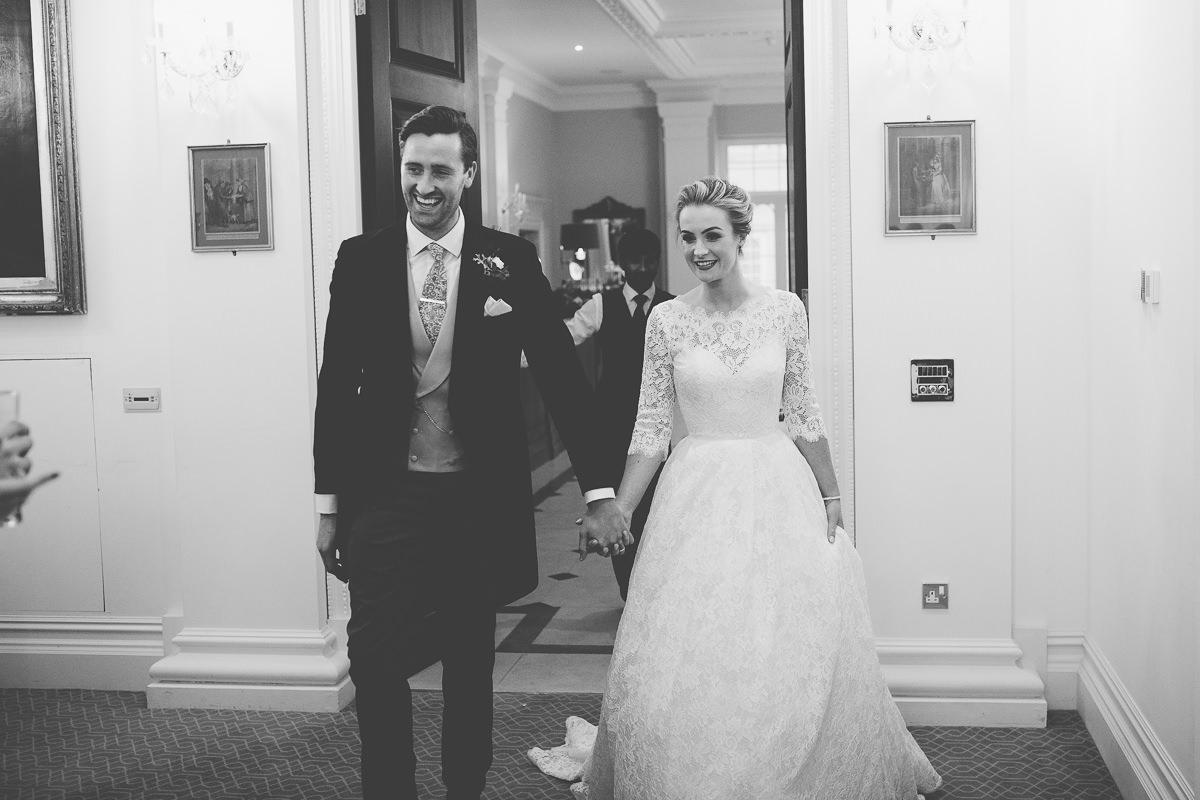 couple enter the wedding breakfast
