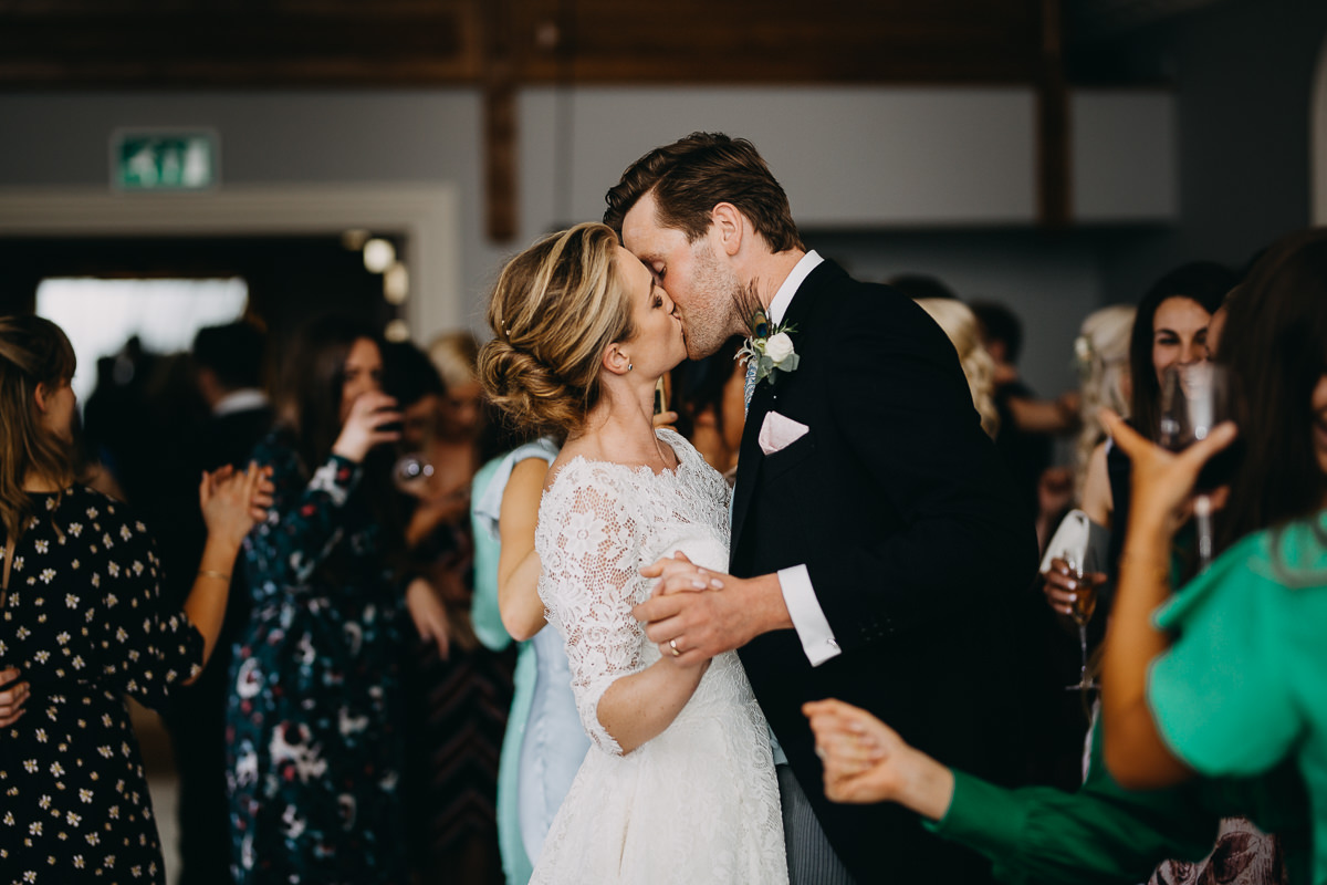 kissing couple during their first dance at Rushton Hall
